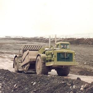 Earthmovers Waikato fleet at speed near Twizel 1974.