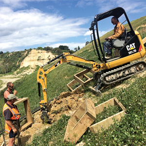 Construction of the 222 box steps down the face of the ANZAC cliff slope was aided by a Cat 301.7D bobcat.