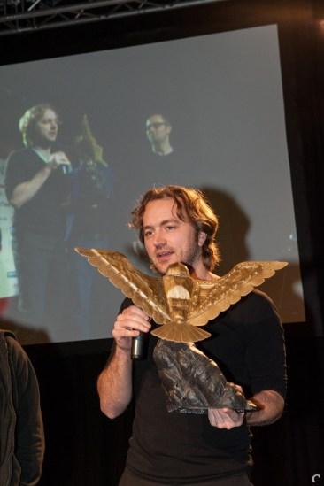 ISOTX-oprichter Vincent van Geel met de award voor Best Online Game