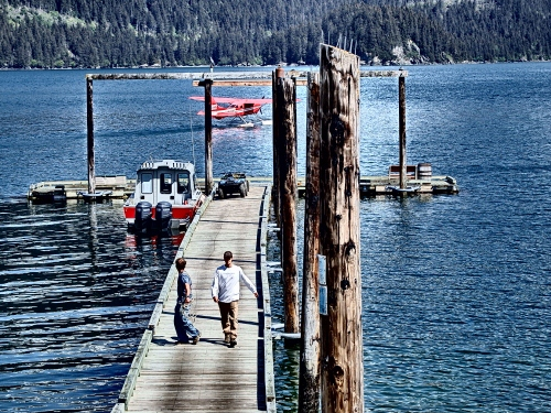 Mark and Gus, the lodge manager, after loading guests into the float plane on the dock