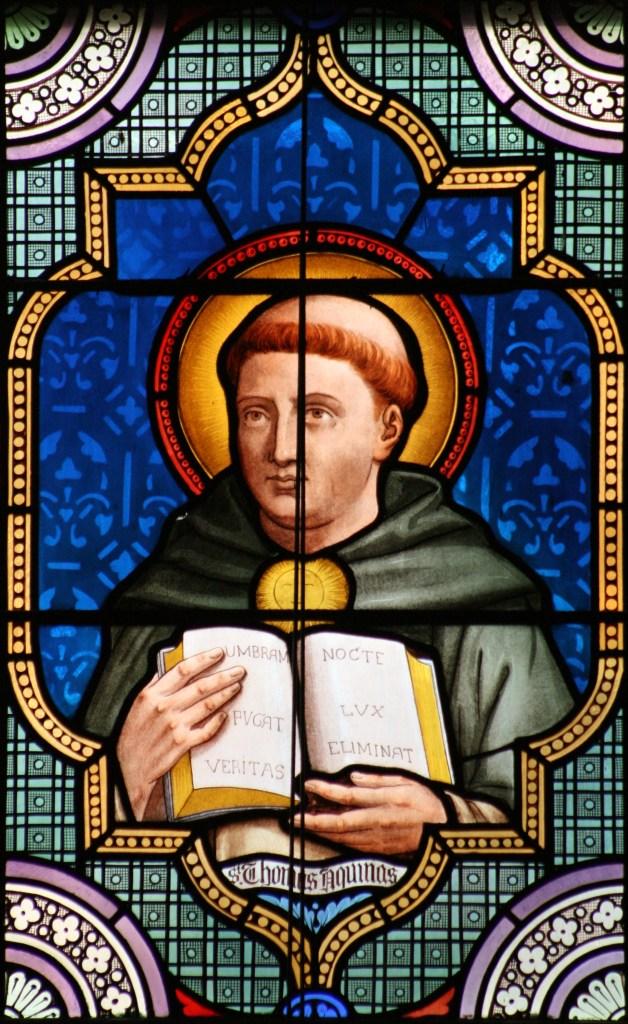 Stained Glass of Thomas aquinas and the summa theologiae