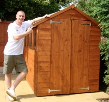 Ben with his shed.