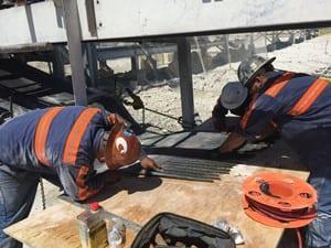 Davis Industrial team splicing conveyor belt