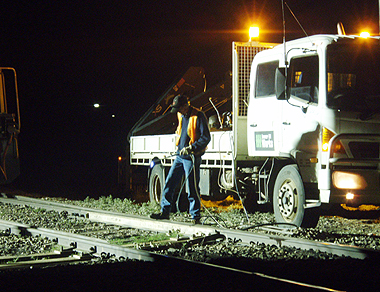 Workers cleared broken wood and debris from the line and assess damage to the rails