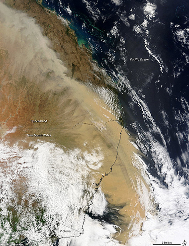 Visible from space: A beige wall of dust can be seen stretching over Queensland and out to sea.  Nasa photo 24-9-2009