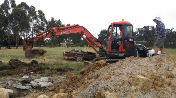 Matt getting a crash course on using a excavator from Mal
