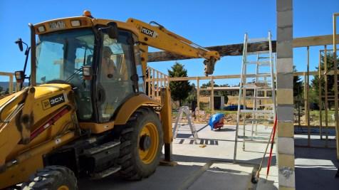 Bert putting the massive beam into place