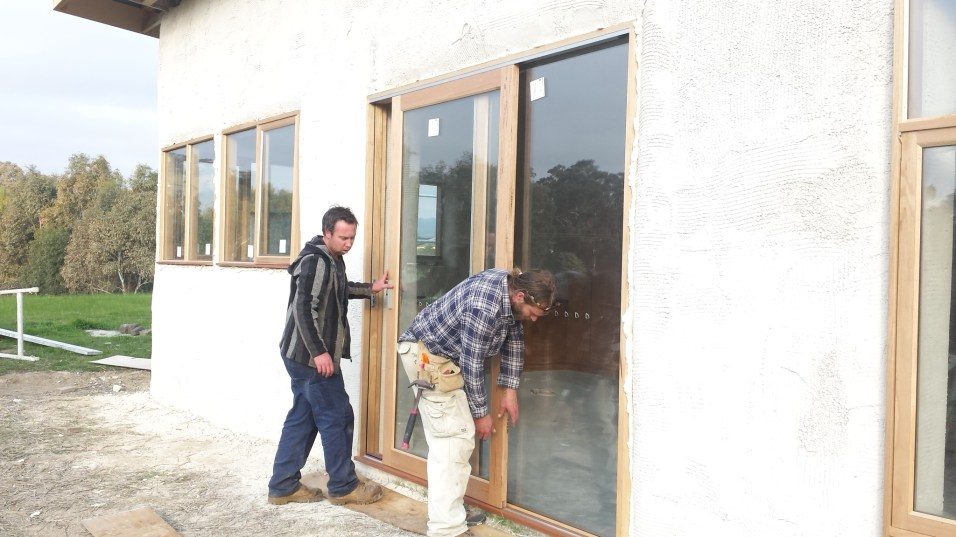 Cam and Matty mounting the front door