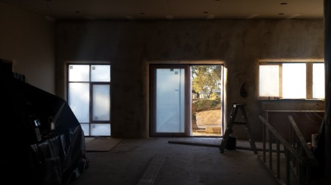 Front doors and north facing windows masked, fireplace covered up