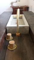 Concrete vanity sink with offset brass taps