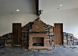 Fireplace grande, crazy paving feature wall and hearth grouted