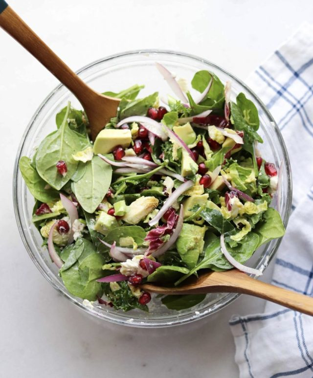 A quick tutorial on how to cut and de-seed a pomegranate, plus a delicious winter salad made with avocado, goat cheese, baby spinach, and a simple balsamic vinaigrette.