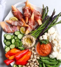 Whole30 Snack Platter - made with homemade romesco sauce, sunflower seed hummus, and lots of fresh vegetables and nuts.