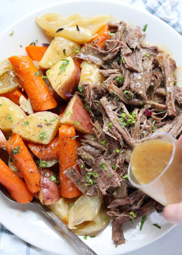 Whole30 Instant Pot Classic Pot Roast, a quick and delicious Paleo and Gluten Free dinner for the whole family! I serve it with red potatoes, carrots, and homemade gravy. Perfect for the meat and potatoes person you love!
