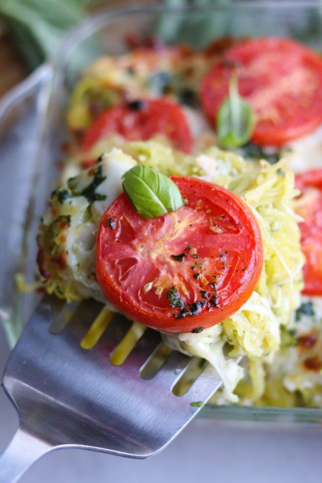 A spatula removing one slice of the Pesto Chicken and Spaghetti Squash Casserole.