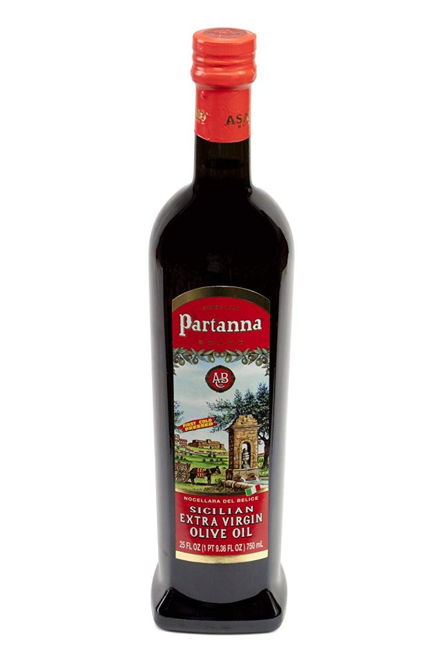 Bottle of Partanna olive oil with red label.