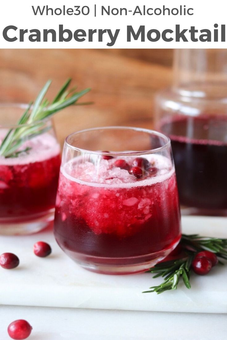 """Close up of finished drink with the text """"Whole30, Non-Alcoholic Cranberry Mocktail"""" for Pinterest."""