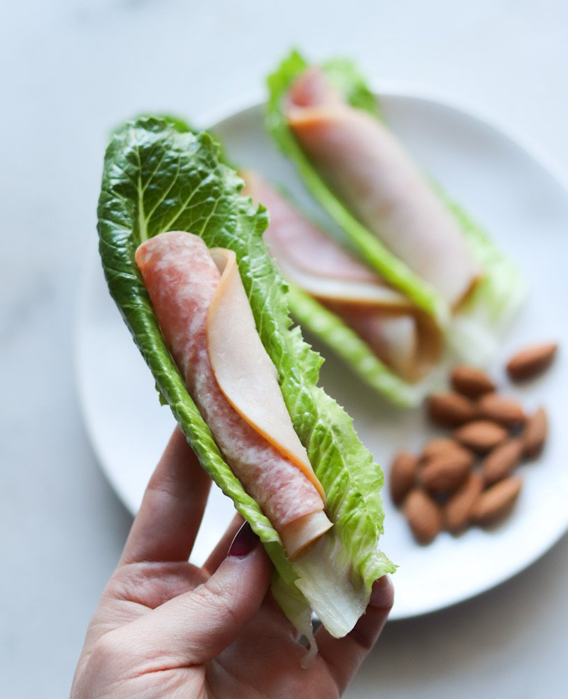 Deli meat rolled up and served inside lettuce wraps as a Whole30 mini meal.