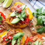 """Pinterest graphic with a close up of the cooked, plated stuffed bell peppers with the text, """"Chicken Fajita Stuffed Peppers."""""""