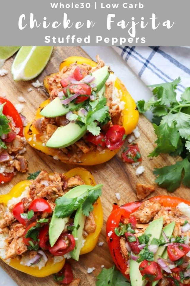 """A close up of the finished stuffed peppers with the text """"Whole30, Low Carb Chicken Fajita Stuffed Peppers"""" for Pinterest."""