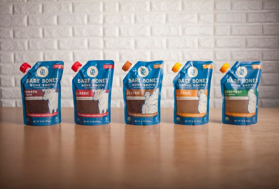 The whole line of Whole30 approved and keto friendly bare bones broths on a table.