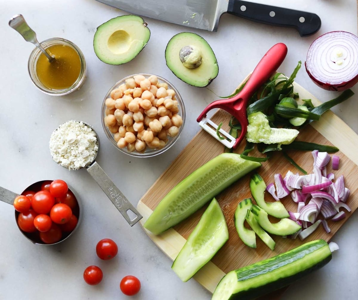 The salad ingredients laid out on a white board.