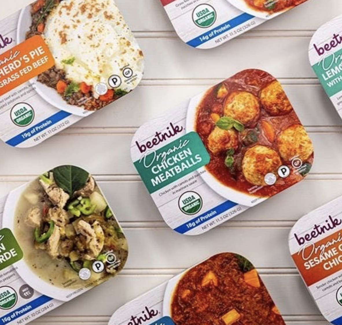 Beetnik Organic frozen meals laid out on a white board.
