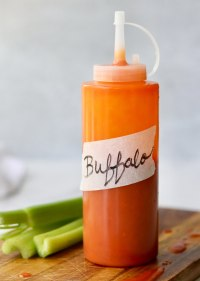 """Side view of a plastic condiment bottle labeled """"Buffalo Sauce."""""""