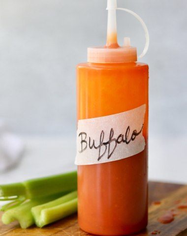 "Side view of a plastic condiment bottle labeled ""Buffalo Sauce."""