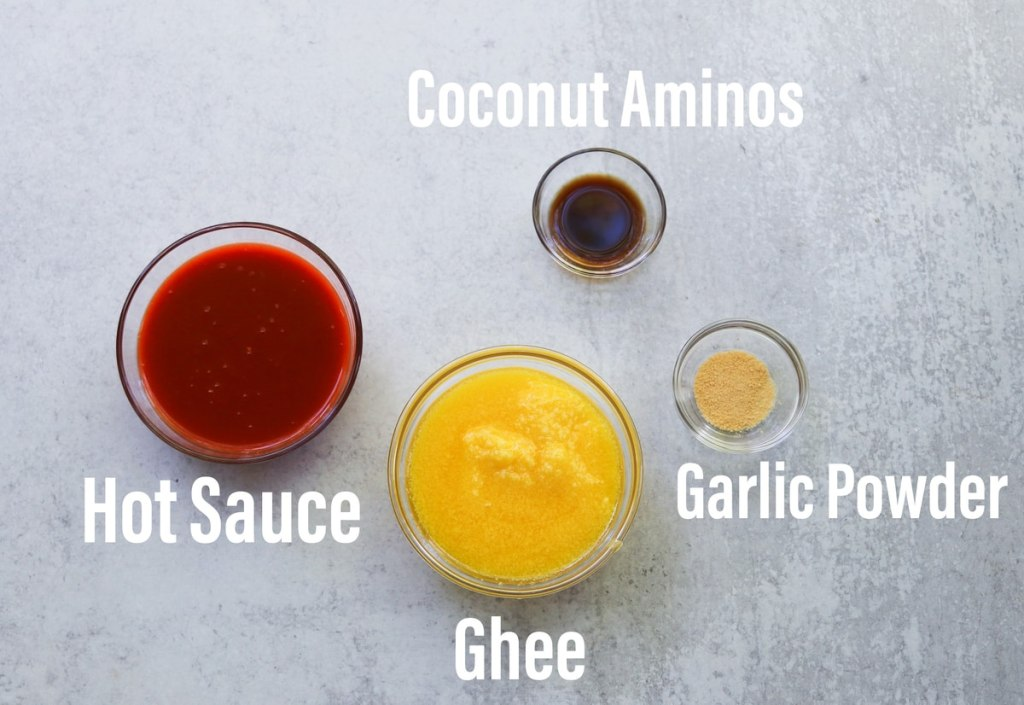 Each ingredient in a small glass dish on a gray board, labeled.