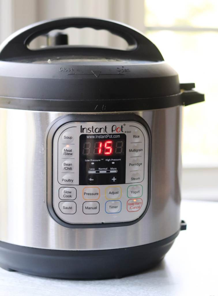 Side view of the Instant Pot set to 15 minutes on High Pressure.
