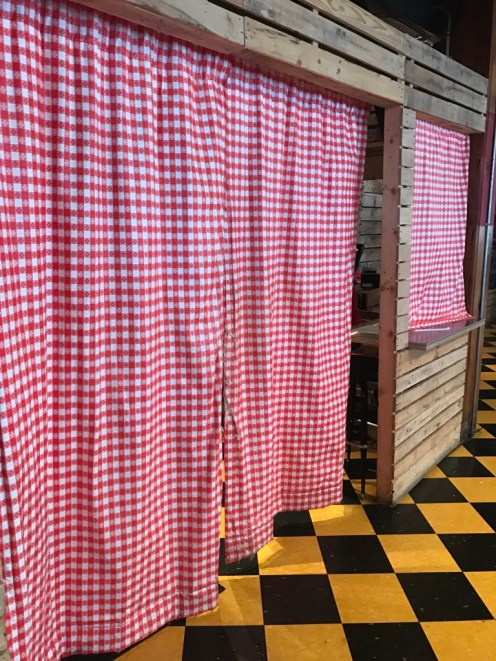 Hot Chicken Takeover's curtain of magic, from behind which comes the most amazing food.
