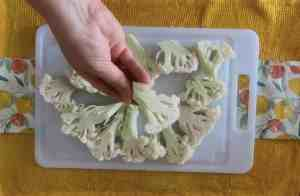 It's ok to use small and large pieces of cauliflower. A smooth edge though will bread easier.