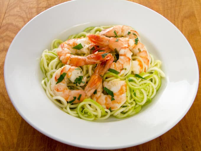 This quick and easy garlic roasted shrimp with zucchini pasta recipe is a great weeknight paleo dinner — you can have it on the table in 20 minutes. | cookeatpaleo.com