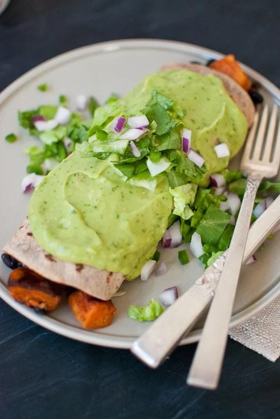 Sweet potato burrito smothered with avocado salsa verde