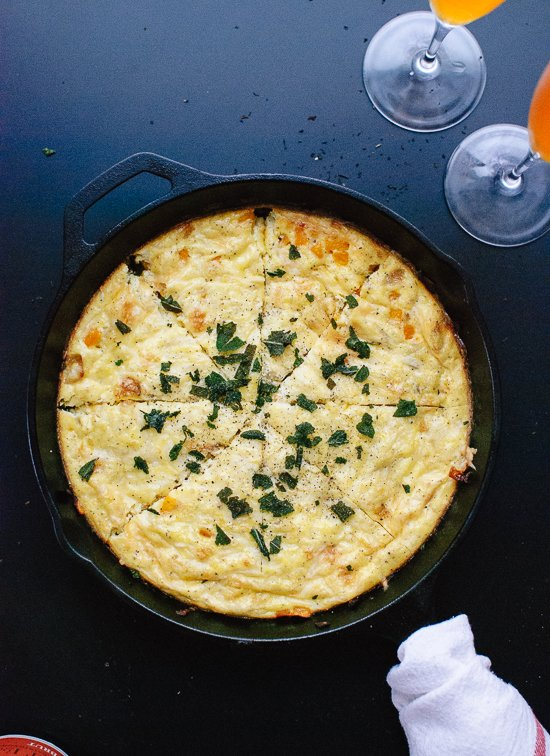Savory butternut squash and Parmesan frittata with fried sage on top - cookieandkate.com
