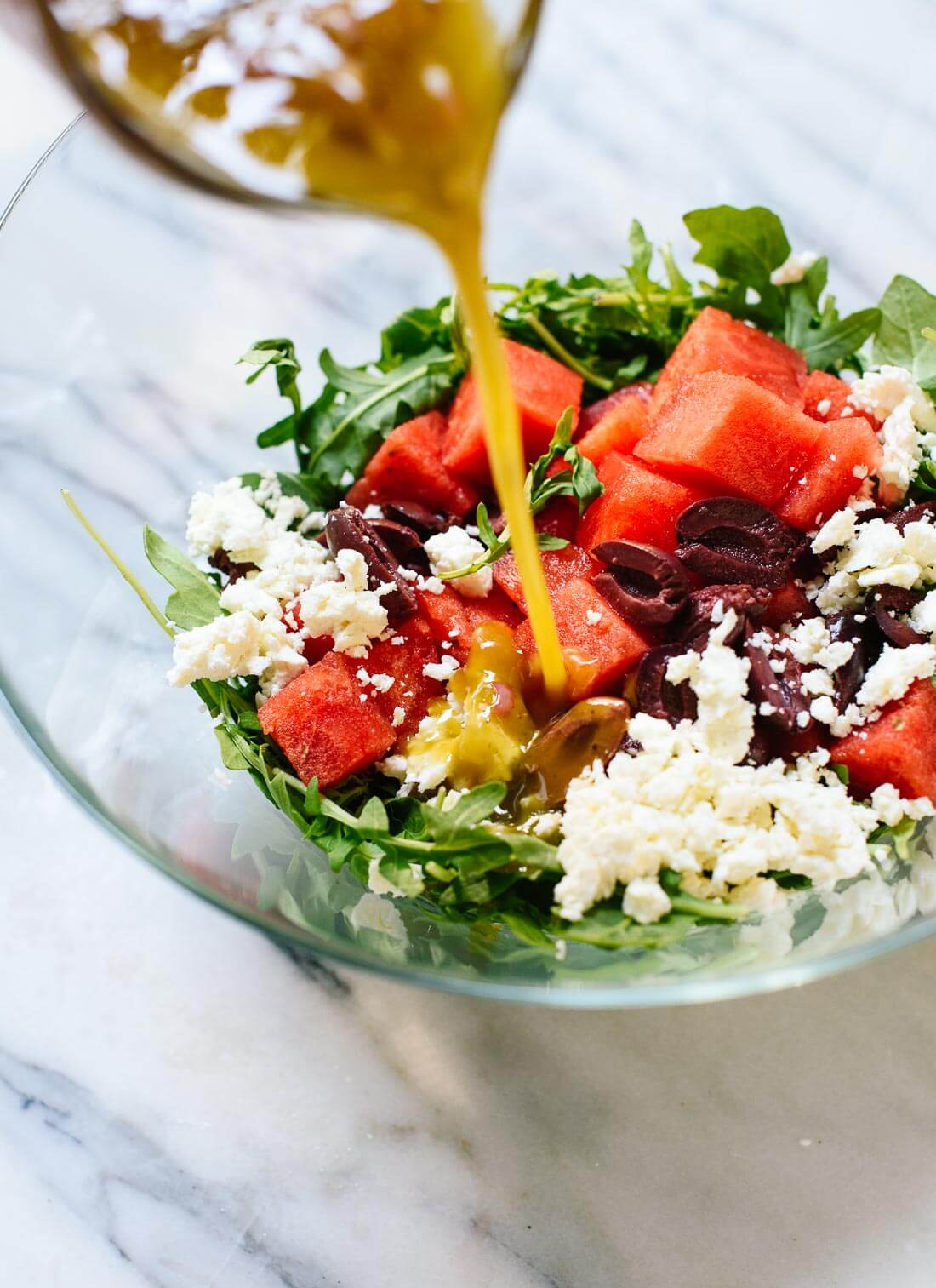 Delicious watermelon salad recipe featuring fresh arugula, feta, and olives with sherry vinaigrette - cookieandkate.com