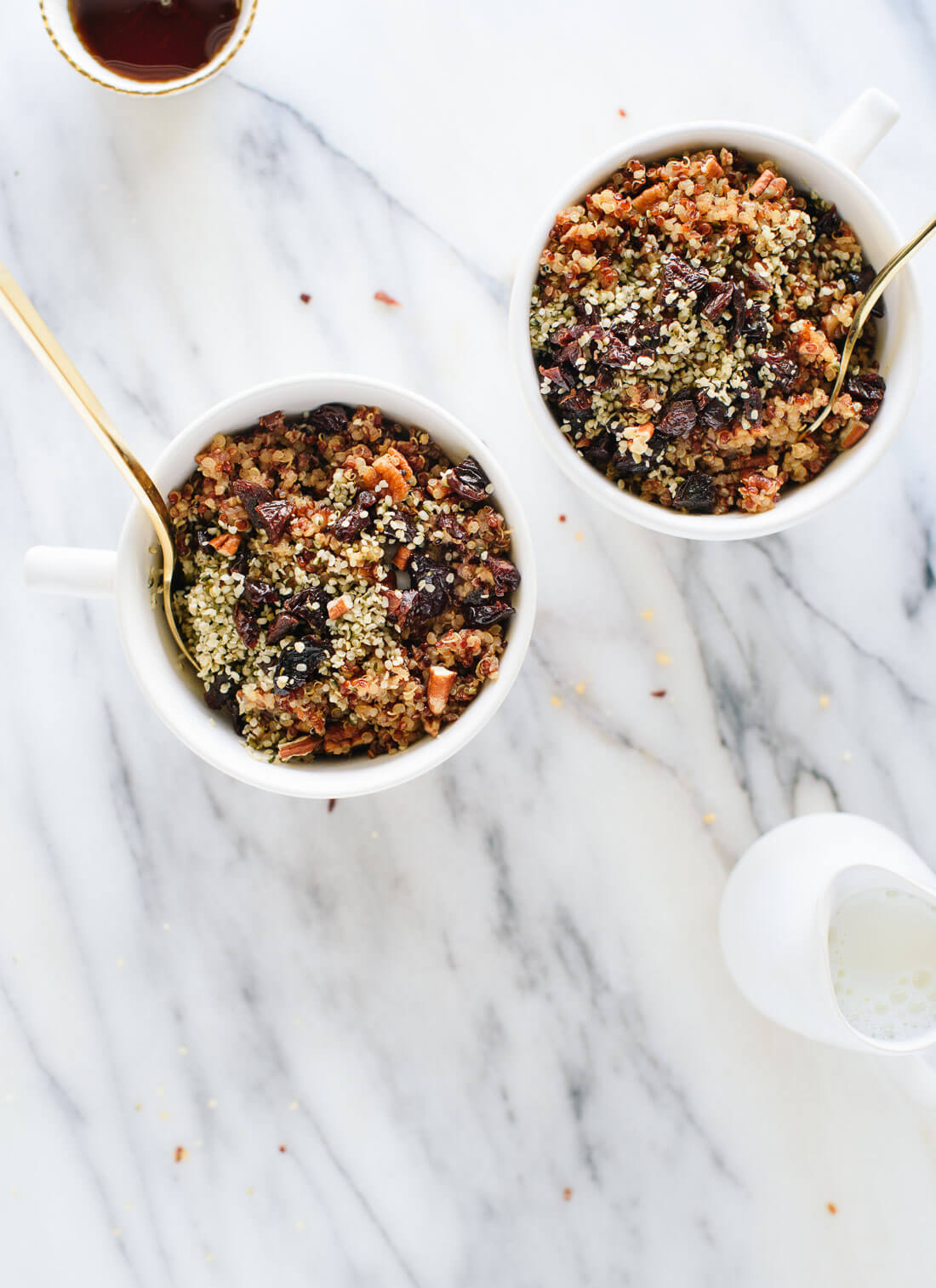 Epic breakfast quinoa featuring toasted pecans, coconut oil, cinnamon and dried cherries or cranberries - cookieandkate.com