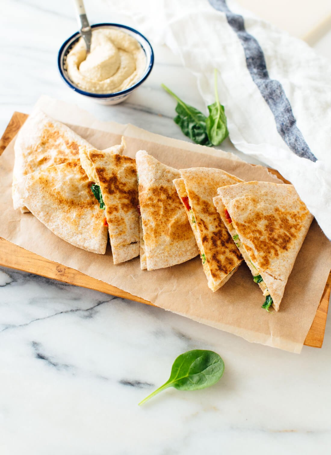 This hummus quesadilla recipe is simple, quick and healthy, too! Dairy-free and vegan (also gluten-free if you use gluten-free tortillas). Get the recipe at cookieandkate.com