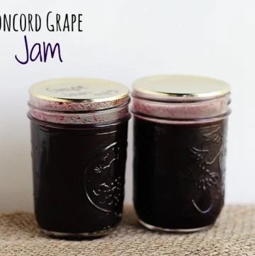 2 canning jars with homemade Concord Grape Jam