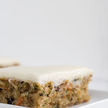 close up of the zucchini bars on a white plate