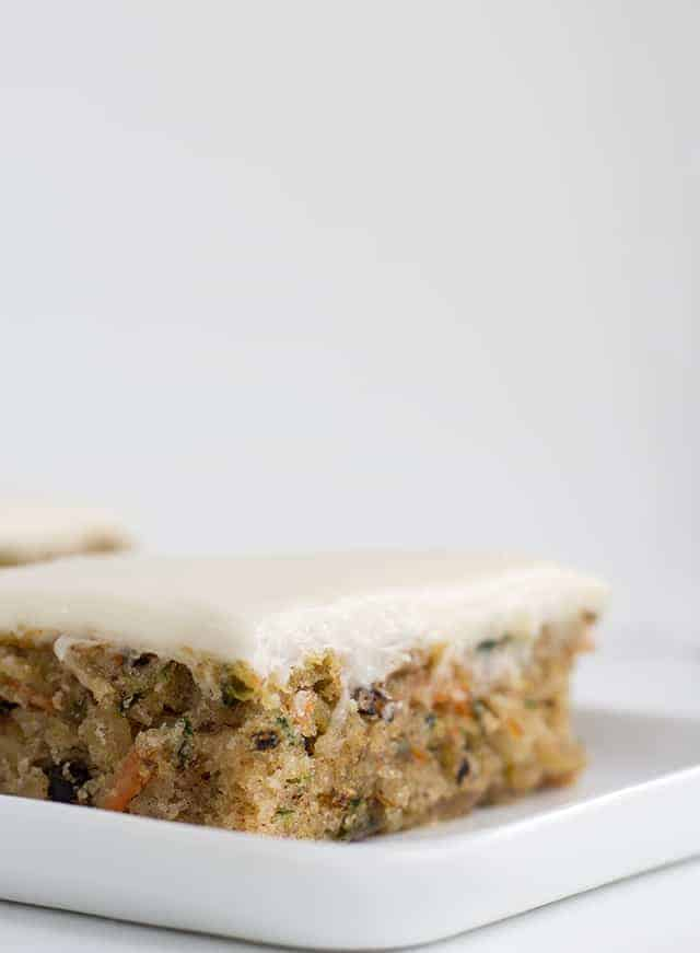 slice of zucchini and carrot spice cake with cream cheese frosting