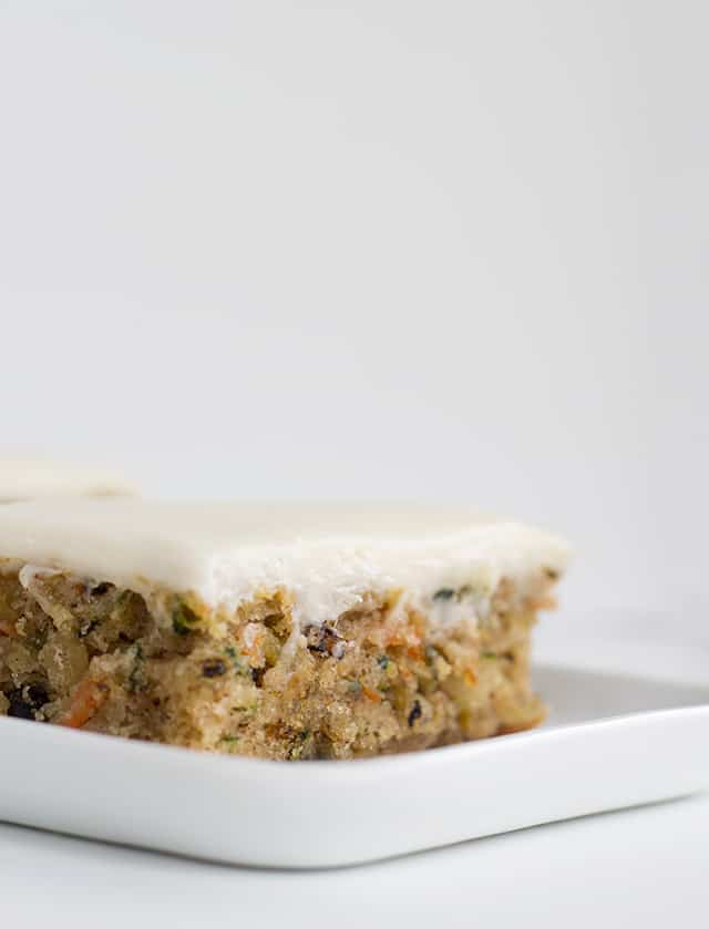 side view of a slice of zucchini bars with cream cheese frosting