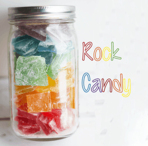 titled image - mason jar filled with homemade rock candy in various colors and flavors