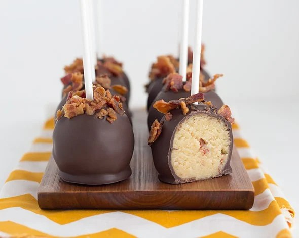 a platter of easy cake pops coated with chocolate and bacon