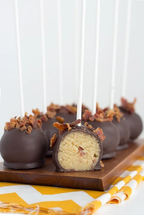 easy cake pops with maple flavor on the inside and chocolate and crispy bacon on the outside