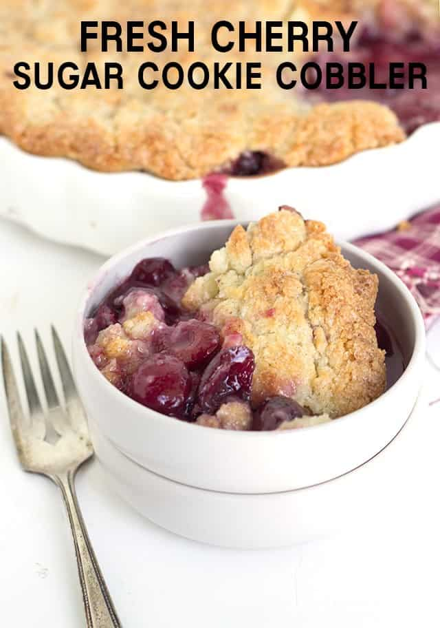 titled image - fresh cherry cobbler with a sugar cookie crust served in a white bowl