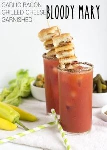 Garlic Bacon Grilled Cheese Garnished Bloody Mary - These are the perfect drinks for a tailgating party. You can have a bite to eat and a delicious zesty drink all in one cup.