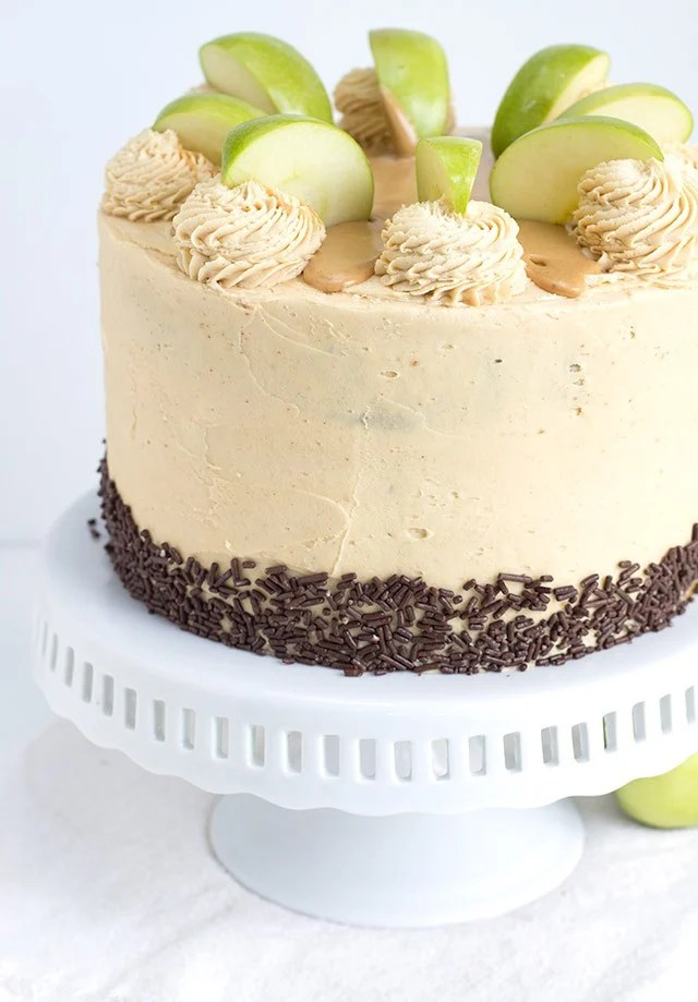 Apple Cake with Peanut Butter Frosting sitting on a white cake stand