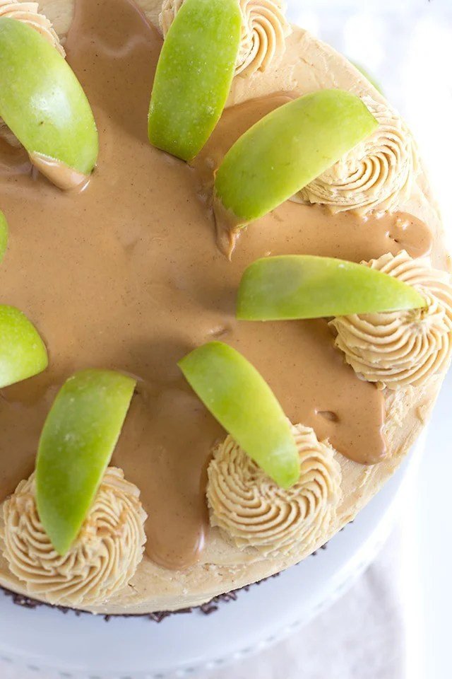 Top view, looking down on an Apple Cake with Peanut Butter Frosting garnished with green apple slices